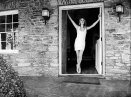 Sharon Tate stands in the doorway of 10050 Cielo Drive, photo courtesy of The Horror Honeys