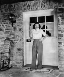 Michele Morgan, the original owner of 10050 Cielo Drive, at the front door, photo courtesy of WorthPoint